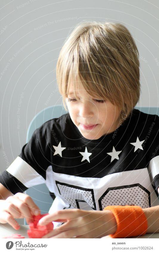 Geduldsspiel Kind Farbe rot schwarz Leben Junge orange Freizeit & Hobby blond authentisch Kindheit Erfolg Kreativität Neugier Bildung T-Shirt