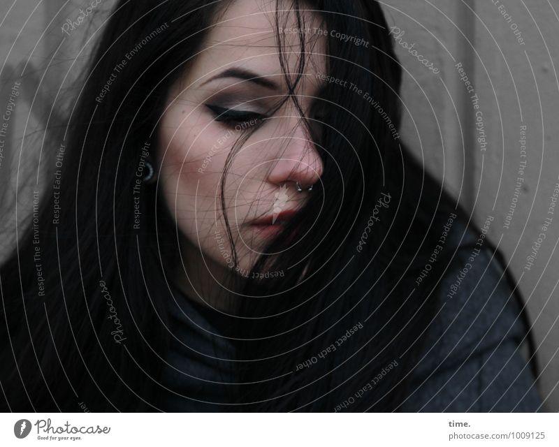 . feminin Junge Frau Jugendliche 1 Mensch Mauer Wand Mantel Piercing Ohrringe schwarzhaarig langhaarig warten schön Gefühle Schutz Selbstbeherrschung