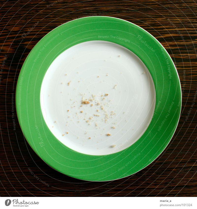 Das war gut Teller grün leer Krümel Knäckebrot lecker Holz Tisch dunkel rund Streifen Frühstück satt fertig Ernährung Backwaren verzehr kümelig Maserung hell