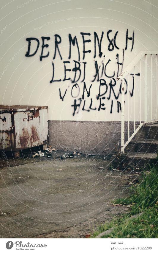 Der Mensch lebt nicht von Brot allein Arbeitslosigkeit Subkultur Stadt Mauer Wand Fassade Schriftzeichen Graffiti Armut dreckig Leben protestieren Text