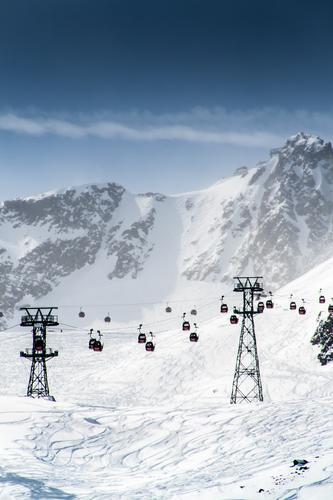 Entspannt zum Gipfel Himmel Natur Ferien & Urlaub & Reisen Landschaft Ferne Winter Berge u. Gebirge Umwelt Schnee Sport Felsen Tourismus Schönes Wetter