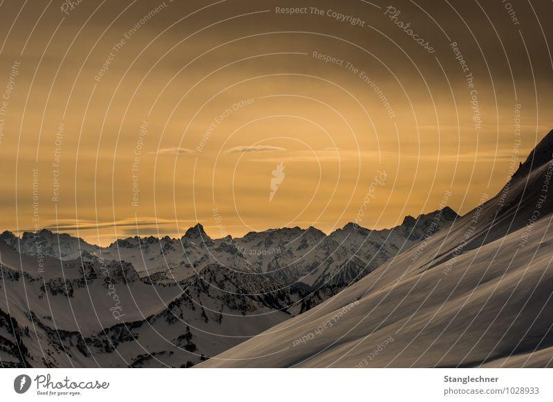 Golden hour Himmel Natur Landschaft Winter Umwelt gelb Berge u. Gebirge Gefühle Schnee außergewöhnlich Stimmung Felsen Horizont Schönes Wetter Abenteuer Gipfel