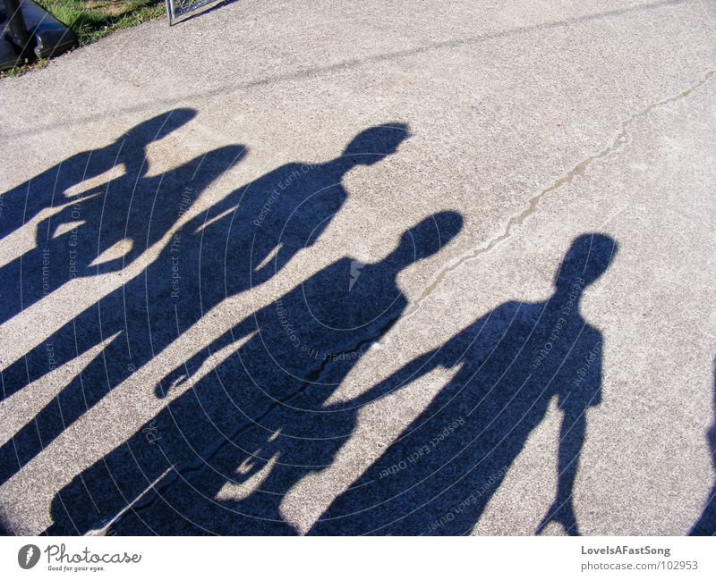 shadows Kind Körperhaltung diagonal Licht Mensch ground black gray white children fun funny sun sunshine light young joy