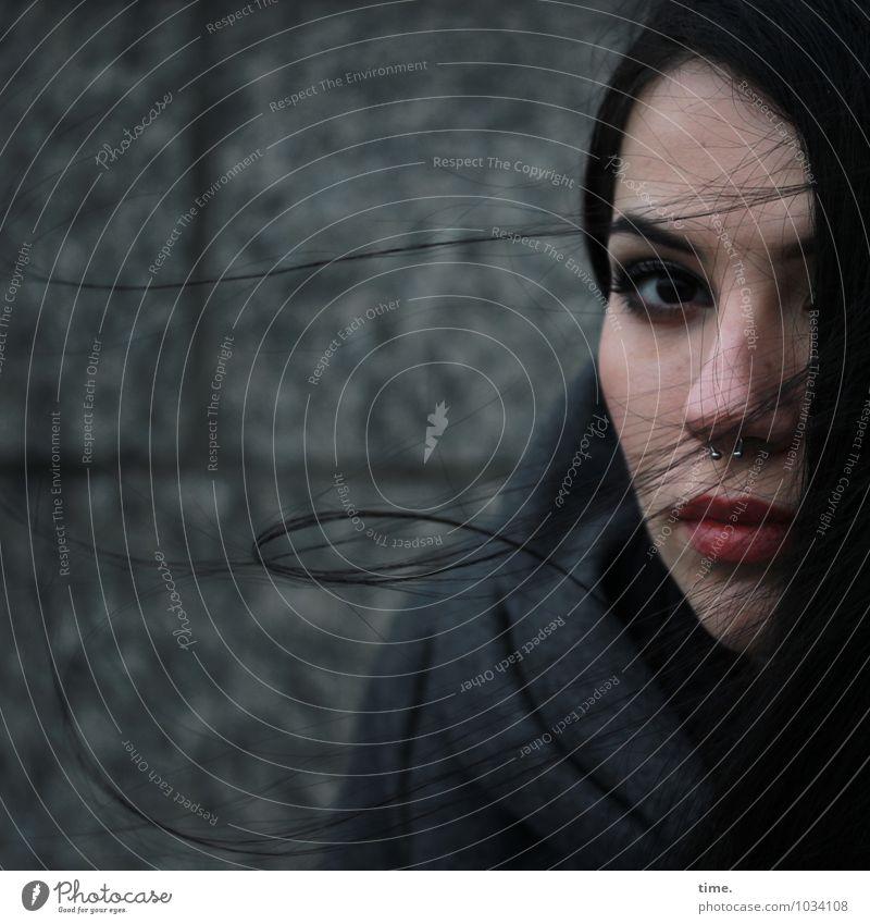 . feminin Junge Frau Jugendliche 1 Mensch Mauer Wand Mantel Piercing schwarzhaarig langhaarig beobachten Denken Blick warten dunkel schön Gefühle Willensstärke