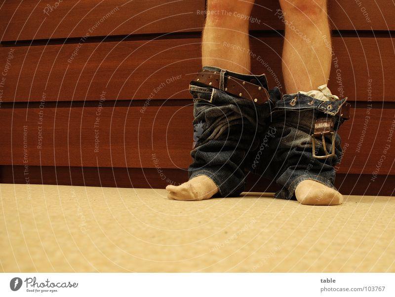 runter... Mensch Mann Erwachsene Beine Fuß 1 Hose Jeanshose Strümpfe Gürtel stehen braun schwarz Frühlingsgefühle Begierde gehorsam Erwartung Lust nackt Scham