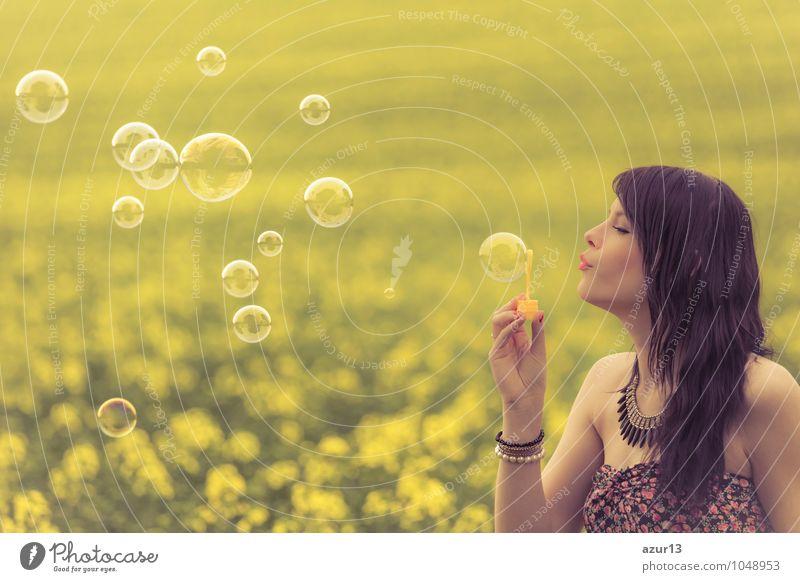 Beautiful woman blowing many soap bubbles in summer nature Frau Natur Sommer Sonne Erholung Blume ruhig Freude Umwelt Erwachsene Frühling Glück Gesundheit