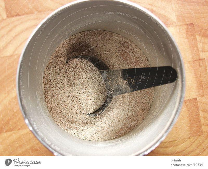Campuccino 2 Pulver Ernährung Getränk Löffel Vogelperspektive Nahaufnahme 1 Menschenleer rund Tasse Milchkaffee trocken Cappuccino Farbfoto