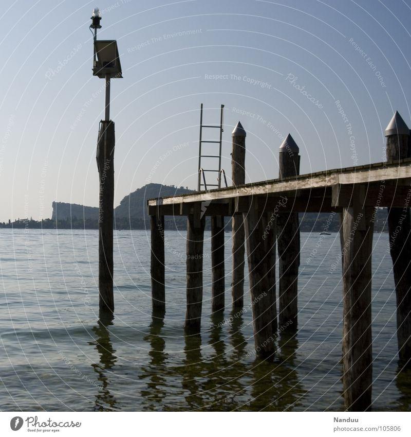 silenzio Wasser Ferien & Urlaub & Reisen Sommer Strand ruhig Erholung Holz Küste See Wellen Zufriedenheit Romantik Kitsch Steg Abendsonne Gardasee