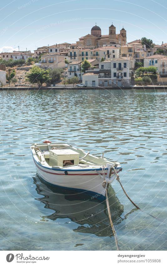 Fischerboot in Gythio. Ferien & Urlaub & Reisen Sommer Meer Industrie Natur Himmel Wolken Küste Hafen Verkehr Wasserfahrzeug alt klein blau weiß Tradition