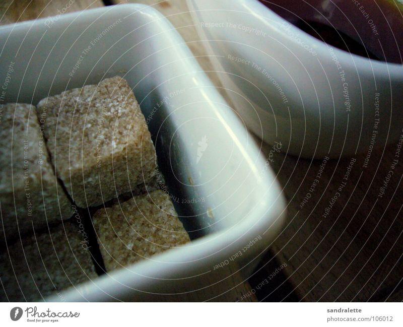 Mit oder ohne? Zucker Brauner Zucker Würfelzucker Tasse Nachmittag Sonntag Gastronomie Makroaufnahme Nahaufnahme Tee tasse tee zuckerschale zuckerschälchen