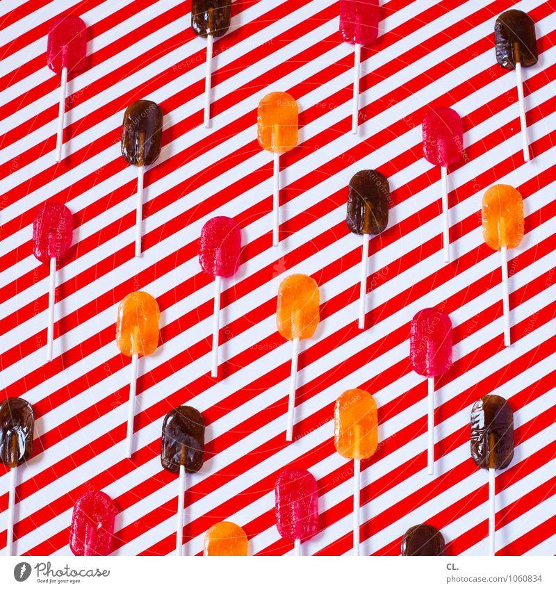 dauerlutscher Lebensmittel Süßwaren Lollipop Ernährung Essen Freude ästhetisch Fröhlichkeit frisch süß braun orange rot weiß Design Farbe Inspiration