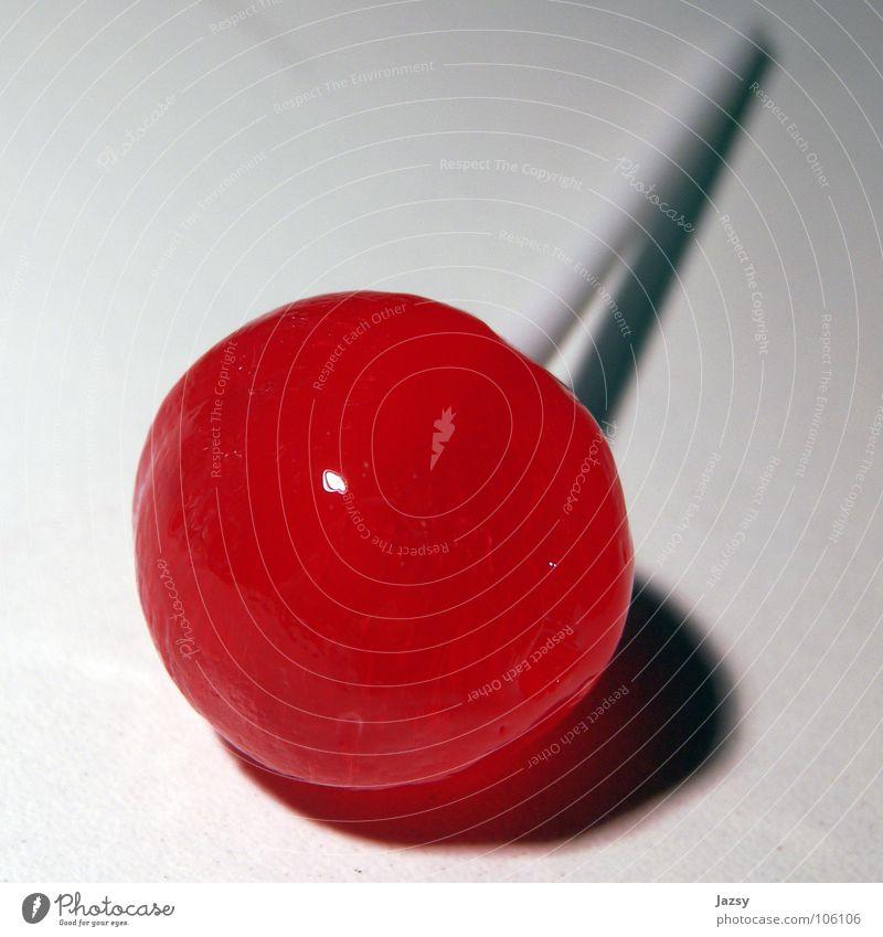 ein williger lollipop weiß rot Farbe süß Süßwaren lutschen Lollipop