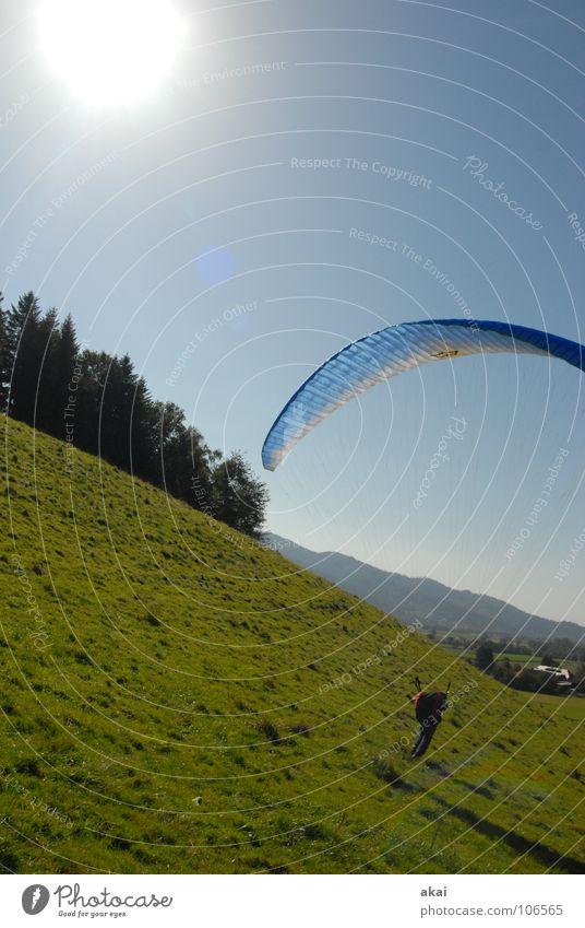 Hanglandung Sonne Freude Farbe Sport Gefühle Beginn Romantik Planet Gleitschirmfliegen Abheben gemalt krumm himmelblau Gleitschirm Freiburg im Breisgau Sonnenuntergang