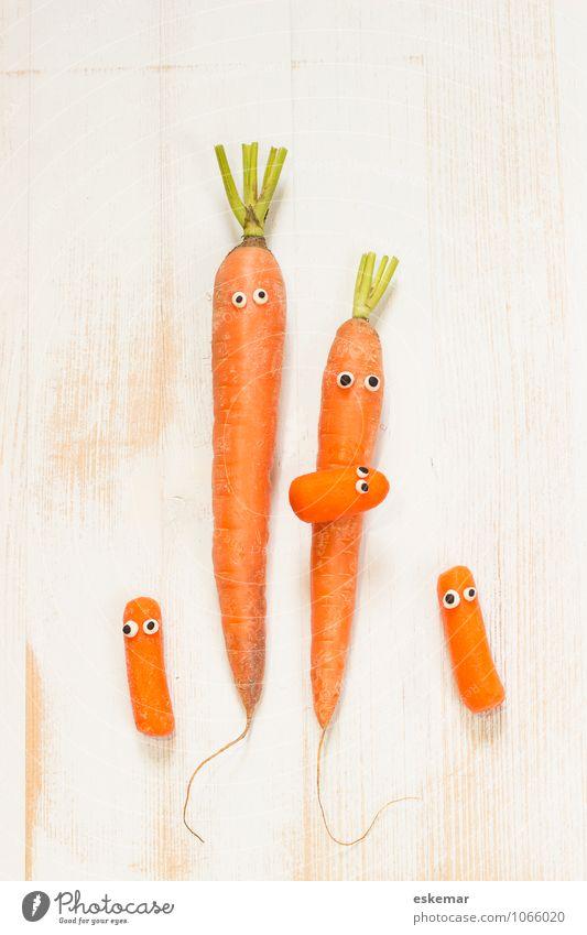 Möhrenfamilie Kind weiß Erwachsene lustig Glück Gesundheit Zusammensein Familie & Verwandtschaft orange frisch Fröhlichkeit Lebensfreude Baby niedlich
