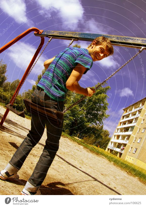 Sitting here, thinking 'bout yesterday II Schaukel Wohnhochhaus Wohnsiedlung Plattenbau Osten schön Spielplatz Mann genießen Erholung Leichtigkeit Denken Glück