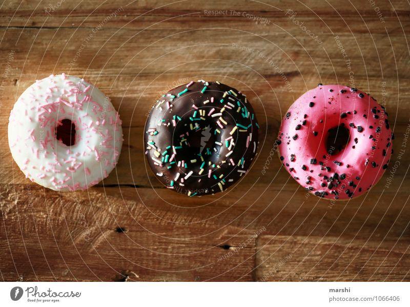 KalorienHochDrei Gefühle Essen Stimmung Lebensmittel Ernährung rund lecker Süßwaren Dessert Fasten Holztisch Krapfen Streusel Kalorienreich