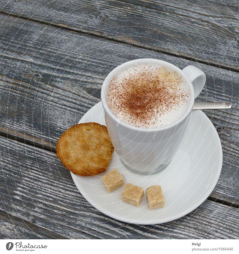 Cappu... Lebensmittel Teigwaren Backwaren Süßwaren Plätzchen Zucker Cappuccino Schaum Kaffeetrinken Getränk Heißgetränk Geschirr Teller Tasse Löffel Tisch Holz