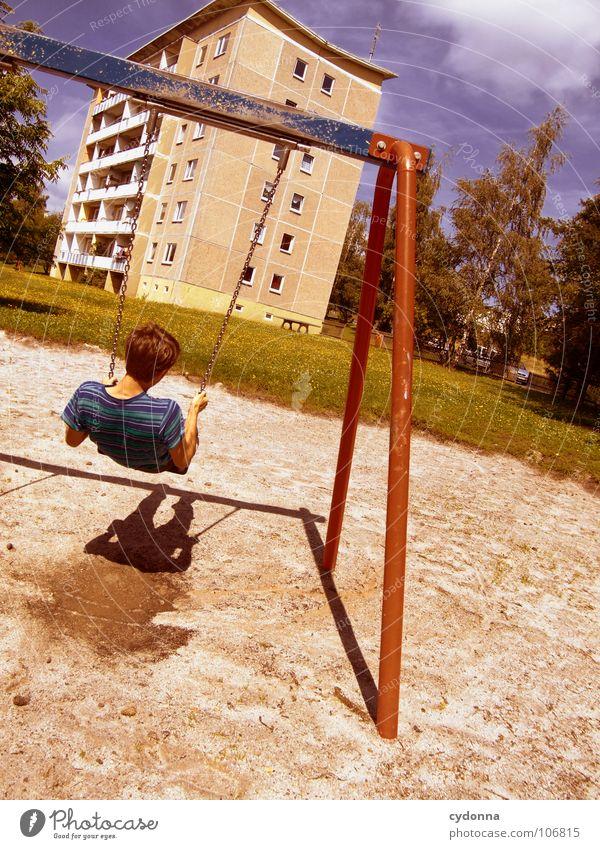 Sitting here, thinking 'bout yesterday V Schaukel Wohnhochhaus Wohnsiedlung Plattenbau Osten schön Spielplatz Mann genießen Erholung Leichtigkeit Denken Glück