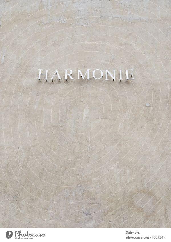 Vorname: Phil Wand Mauer grau Fassade Buchstaben harmonisch Wort Putzfassade