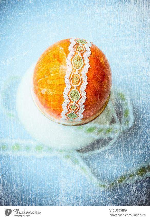 Oranges Osterei mit Schleife blau Haus gelb Leben Innenarchitektur Stil Feste & Feiern orange Design Dekoration & Verzierung Tisch Zeichen retro Ostern