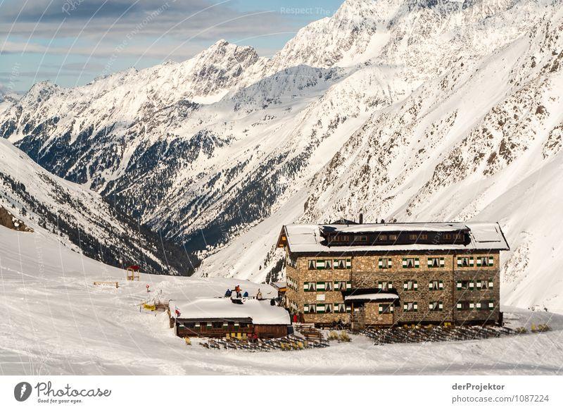 Hütte mit Kulisse Natur Ferien & Urlaub & Reisen Landschaft Winter Berge u. Gebirge Umwelt Schnee Sport Freiheit Felsen Tourismus Idylle Schönes Wetter