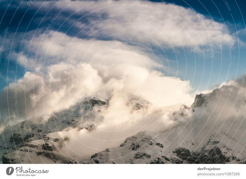 Licht- und Wolkenspiel am Berg 4 Natur Ferien & Urlaub & Reisen Pflanze Landschaft Tier Ferne Winter kalt Berge u. Gebirge Umwelt Schnee Freiheit Felsen Eis