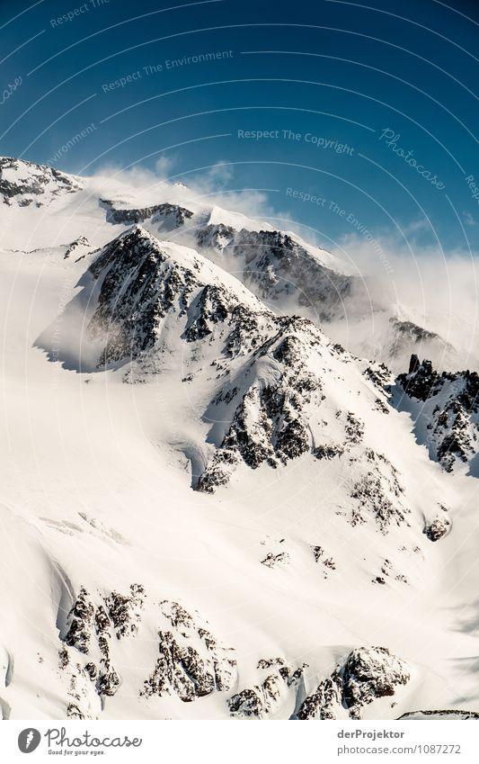 Licht- und Wolkenspiel am Berg 3 Natur Ferien & Urlaub & Reisen Pflanze Landschaft Tier Freude Ferne Winter Berge u. Gebirge Umwelt Schnee Freiheit Felsen Tourismus Eis ästhetisch