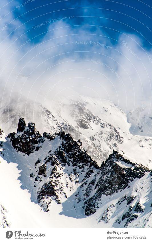 Wolkige Berge Ferien & Urlaub & Reisen Tourismus Ausflug Abenteuer Ferne Freiheit Schnee Winterurlaub Berge u. Gebirge Umwelt Natur Landschaft Pflanze