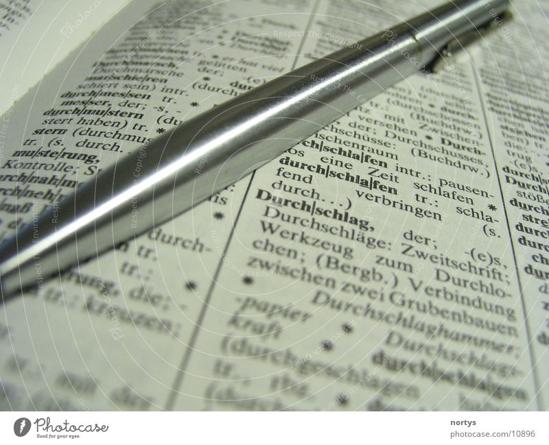 Lesen und Schreiben Dinge Buch Schreibstift Wissen Lexikon Kugelschreiber