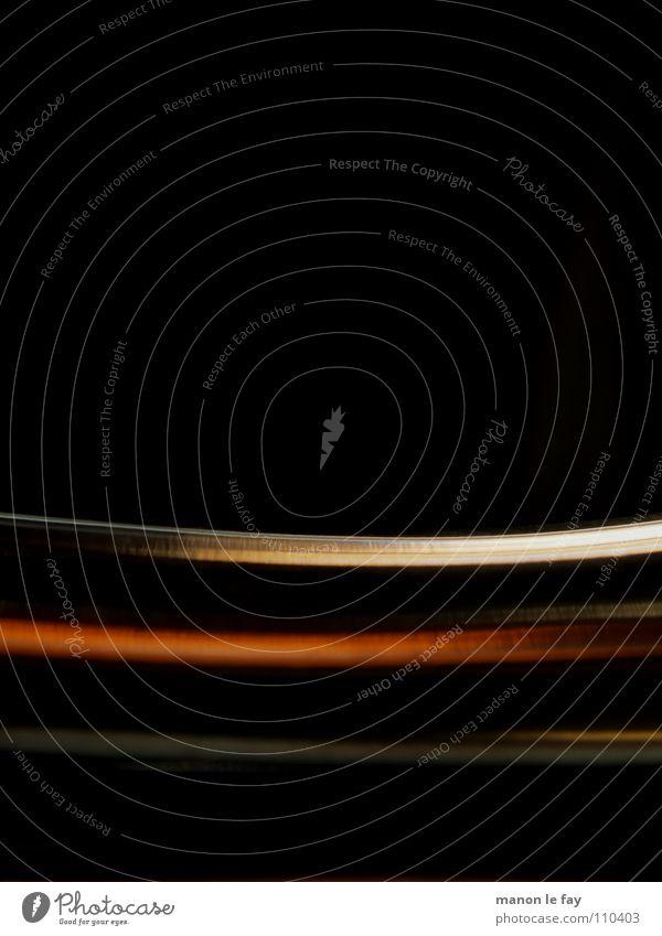 Scheibenwelt Streifen schwarz gekrümmt geschmeidig Licht obskur orange blau Reflexion & Spiegelung