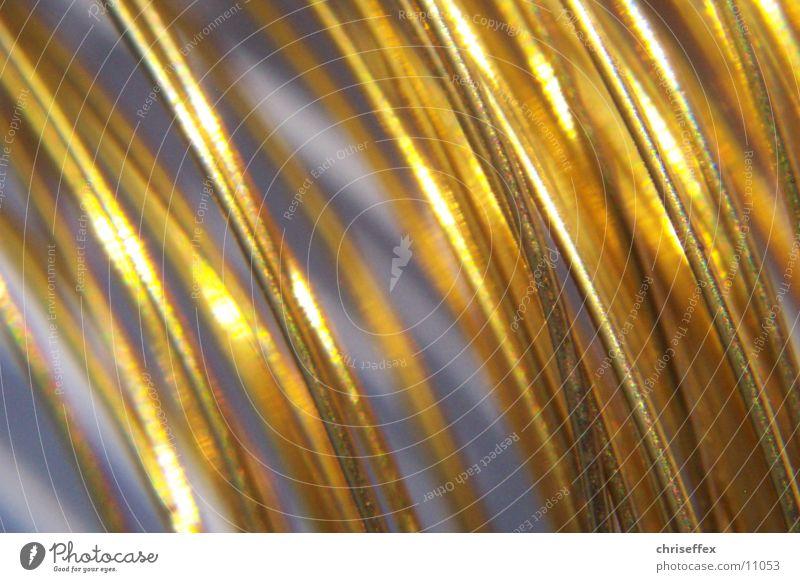 goldthinx Draht chaotisch Schlaufe Makroaufnahme Nahaufnahme Wiederholung