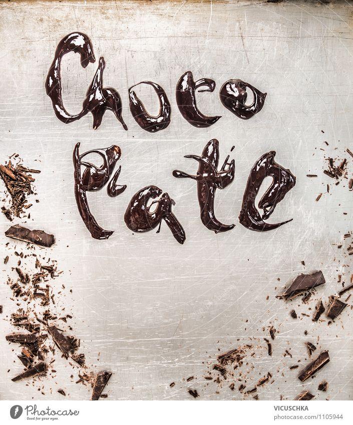 Aufschrift Chocolate mit schmelzender Schokolade alt schön Stil Hintergrundbild Foodfotografie braun Lebensmittel Metall glänzend Design Ernährung