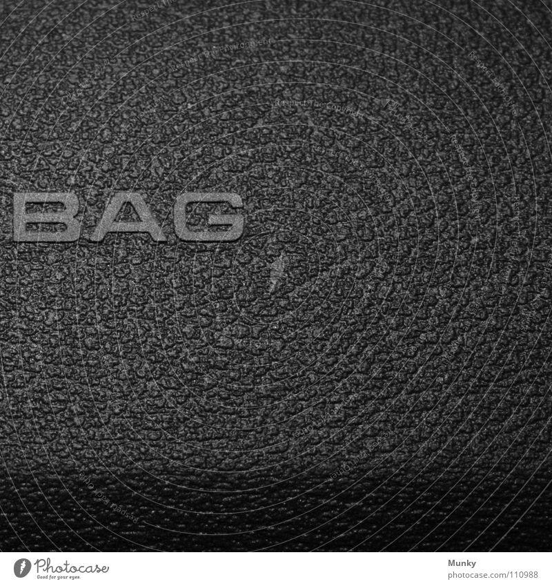 BAG Luft Airbag grau schwarz Aufschrift Buchstaben Sicherheit Quadrat zweiteilig 2 Makroaufnahme Nahaufnahme Munky PKW Amaturenbrett secure Schatten