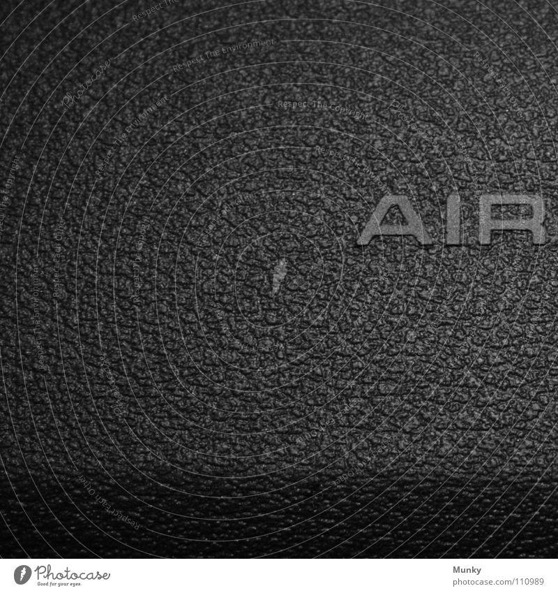 AIR Luft Airbag grau schwarz Aufschrift Buchstaben Sicherheit Quadrat zweiteilig 2 Makroaufnahme Nahaufnahme Munky BAG PKW Amaturenbrett secure Schatten