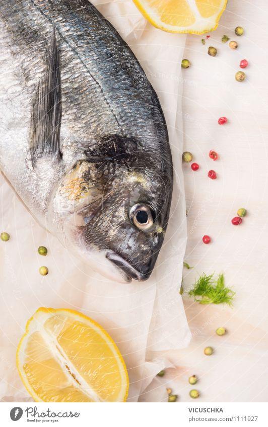 Ein gutes Paar - Dorade Fisch und Zitrone. Natur weiß Gesunde Ernährung Leben Stil Essen Lebensmittel Lifestyle Design Tisch Papier Kräuter & Gewürze Küche