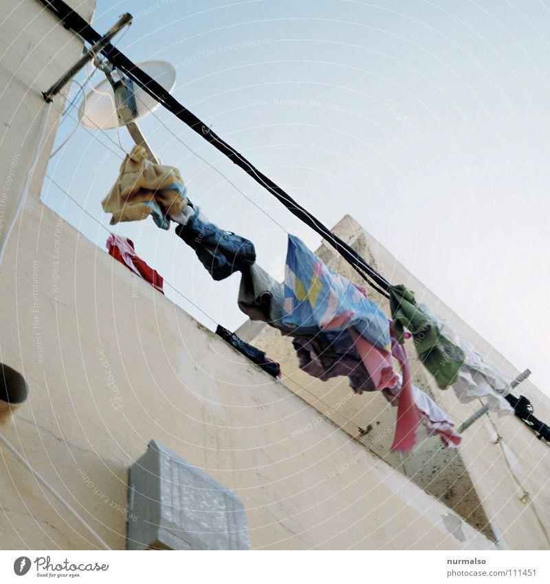 Ecological laundry dryer in the square Wäsche hängen trocken trocknen Unterwäsche Elektrizität frisch weiß Koloss Waschmittel Waschmaschine Terrasse Balkon