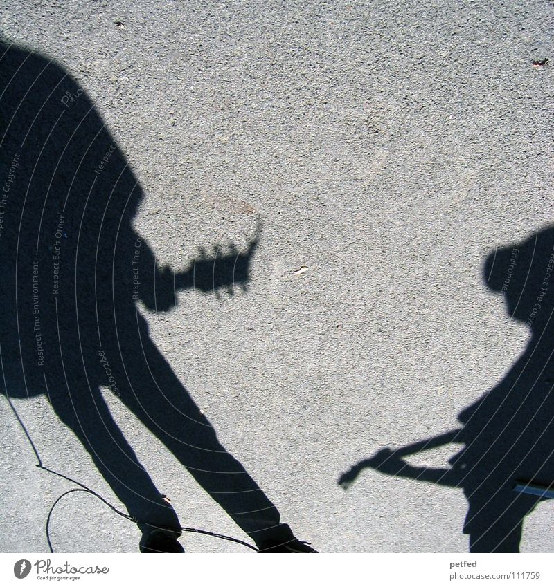 Schattencombo Mensch Freude schwarz Straße Leben Spielen grau träumen Freizeit & Hobby Musik Kultur Konzert Künstler Gebet Gitarre Österreich