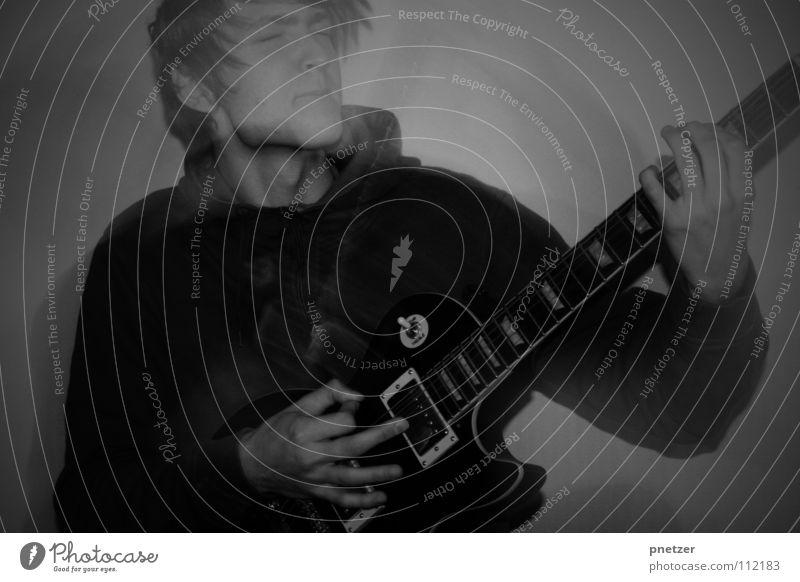 Rocking Spielen Mann laut Geschwindigkeit schwarz weiß Riff Griff Freude Konzert Musik Jugendliche Rockmusik Gitarre les paul guitar