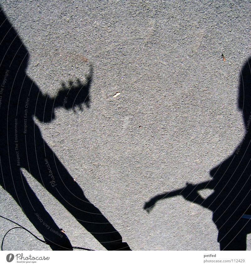 Schatten_TD Mensch Mann Freude schwarz Straße Leben Spielen grau träumen Freizeit & Hobby Musik Kultur Konzert Künstler Gebet Gitarre