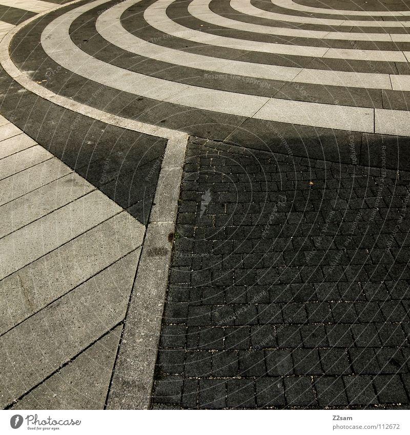 leitsystem Leitfaden Muster Bodenbelag Geometrie Stil graphisch Kreis Wellen dunkel weiß Verlauf Asphalt Teer Leitsystem rund eckig Quadrat Dinge