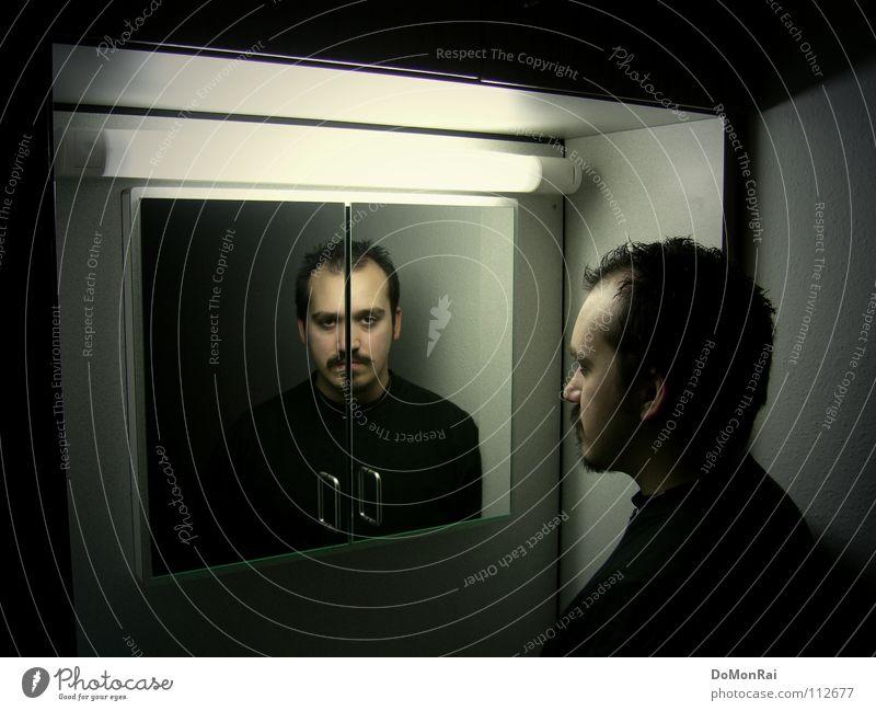 Doppelter Zwiespalt Mensch Jugendliche schwarz dunkel Kopf Traurigkeit Denken Angst Erwachsene trist Spiegel Bart Mann Neonlicht ernst Zweifel