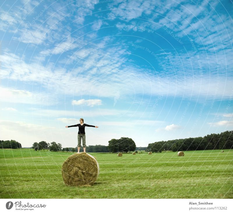 enjoying the nature Natur Meditation Blauer Himmel Sommer springen Freude Frau meadow country side young woman bale hay green grass spread arms freedom