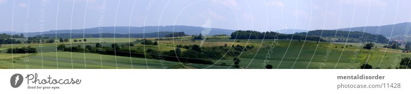 über den Feldern Panorama (Aussicht) Gras Hügel Landleben Himmel Berge u. Gebirge groß Panorama (Bildformat)