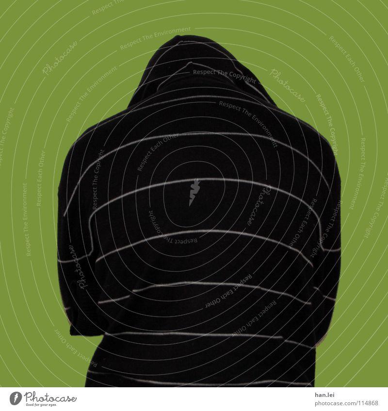 Auch ein Rücken... Mensch Pullover Mütze drehen hängen grün Schwäche Wand lassen fremd unerkannt self Kapuze rückwärts nicht anonym Farbfoto Blick nach unten