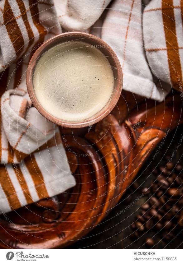 Tasse Kaffee auf alten Holztisch mit Küchentuch dunkel Stil Hintergrundbild Lebensmittel Lifestyle Design Häusliches Leben Tisch Getränk retro Café Frühstück