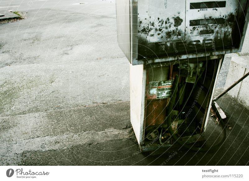 it´s better to burn out... Tankstelle tanken kaputt ausgebrannt alt Benzin Diesel Sprit Beton Teer Platz repariert Besen Kehren Detailaufnahme hinüber petrol