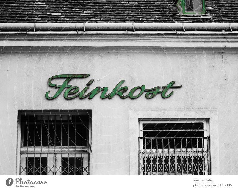 Feine Kost Gewerbe Ladengeschäft Lebensmittel Gitter Fenster Colorkey Typographie verfallen feinkost greissler