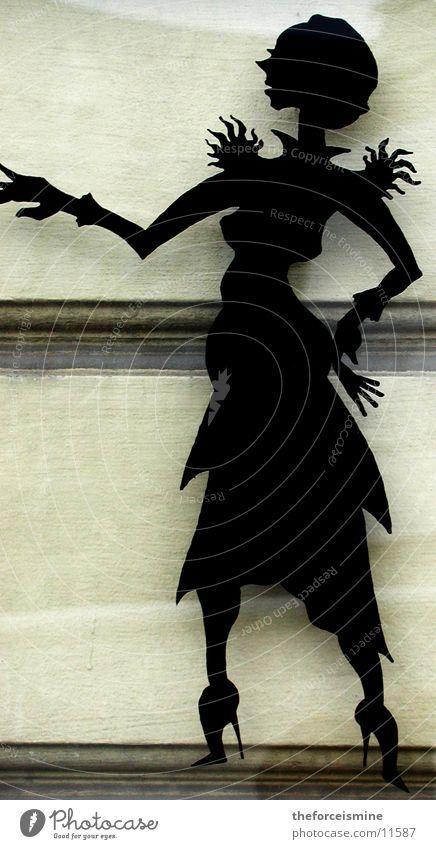 Silhouette einer Frau feminin Wand Mauer klassisch Schattenspiel Fototechnik