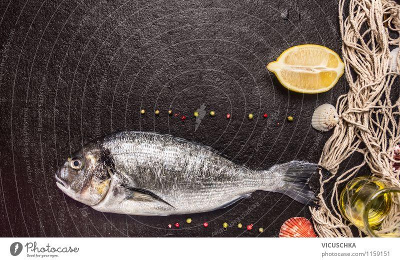 Mehr Fisch essen: Dorade zubereiten Gesunde Ernährung dunkel Stil Essen Hintergrundbild Foodfotografie Stein Lebensmittel Design Ernährung Kräuter & Gewürze Fisch Netz Bioprodukte Abendessen Diät