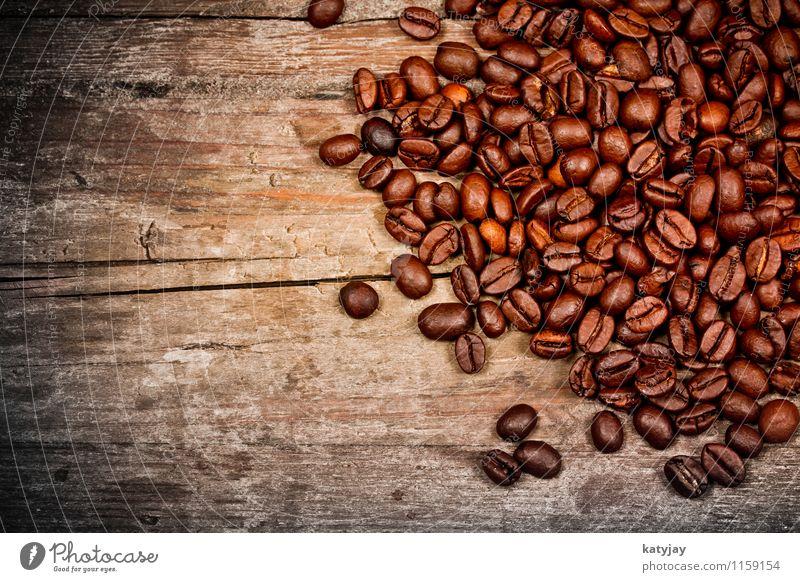 Kaffeebohnen Espresso anbau Hintergrundbild Cappuccino arabica Holzbrett Holzplatte reizvoll aromatisch Bohnen Café Energie Fairness frisch Frühstück genießen